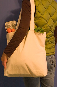 Woman carrying a reusable bag