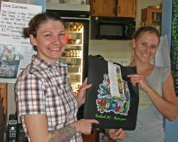 Grind staff holding a Rossland reusable bag
