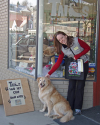 Owner of Tails pet supply, Amanda Wells, with local dog, Nutsi
