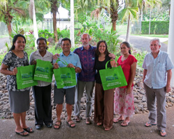 The Waste Management Team from SPREP, in Samoa with Tracey, proudly showing off their Clean Pacific reusable bags.